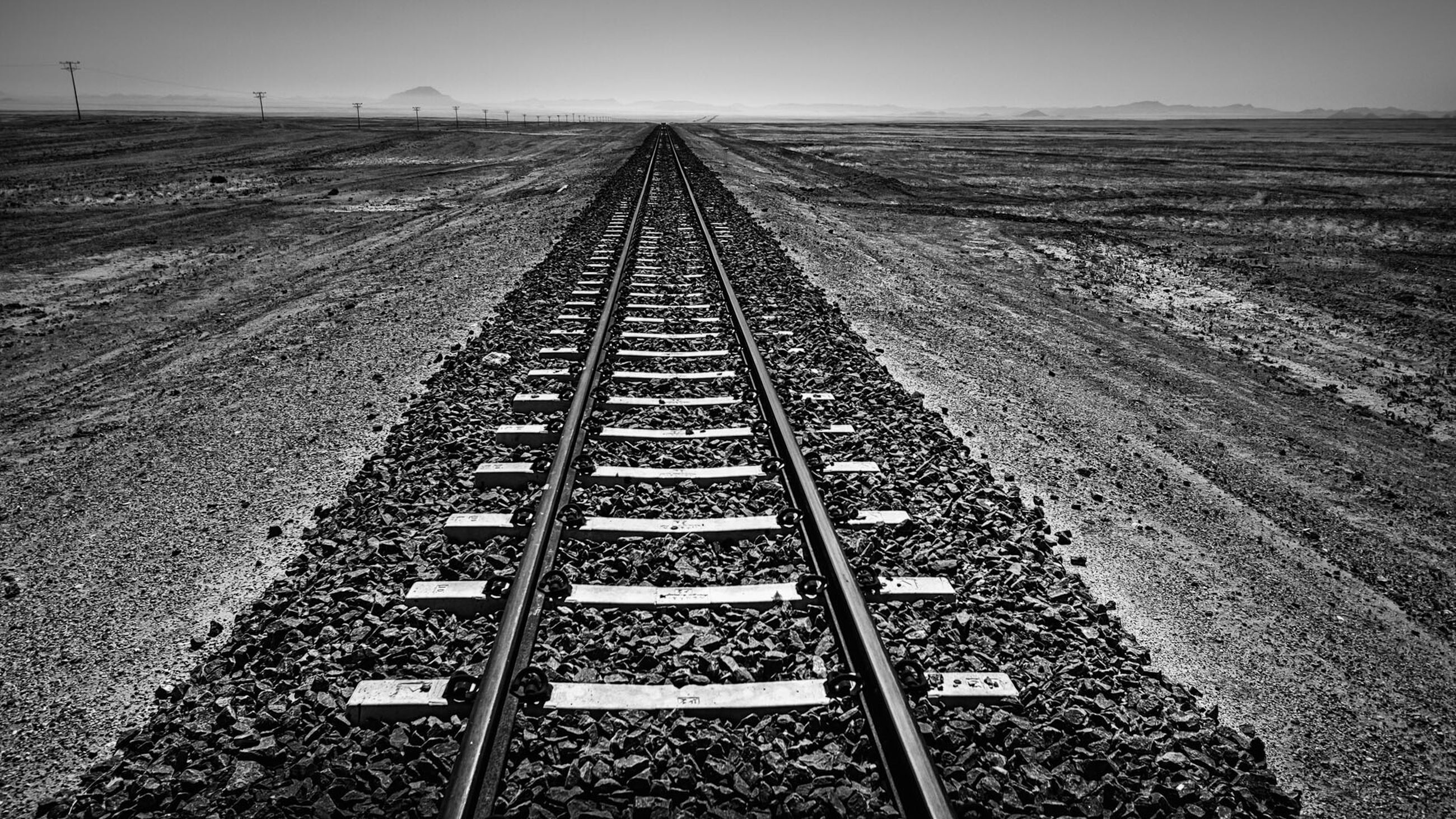the way forward, diminishing perspective, vanishing point, transportation, landscape, railroad track, tranquility, tranquil scene, sky, nature, scenics, rail transportation, beauty in nature, high angle view, outdoors, day, clear sky, long, sunlight, travel
