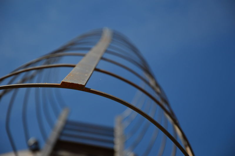 Low angle view of spiral staircase against blue sky