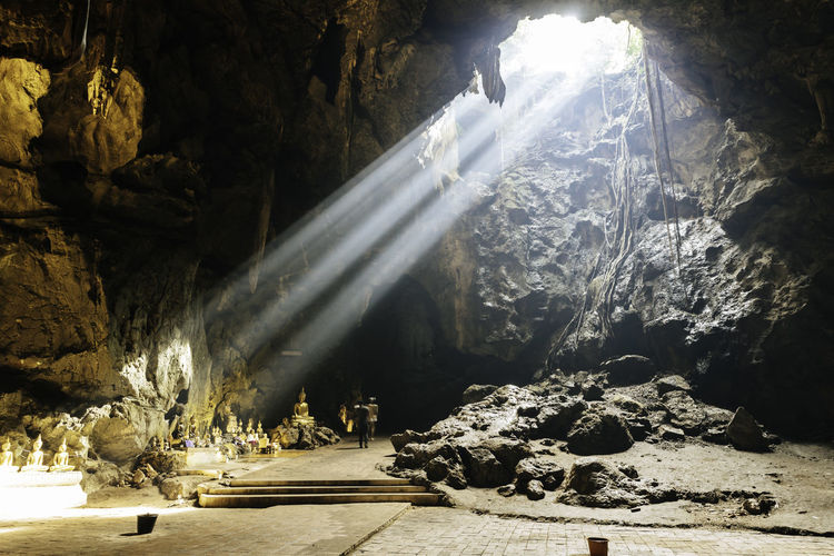Sunlight streaming through rocks in cave
