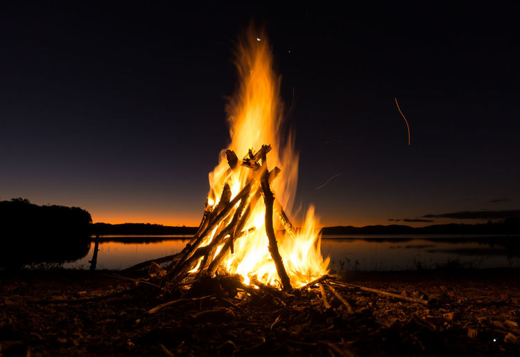 Camp fire in the evening. Fire - Natural Phenomenon Flame Heat - Temperature Burning Nature Night Beach Water Igniting Vacations Outdoors Beauty In Nature Sea Sky No People Fresh On Market 2016