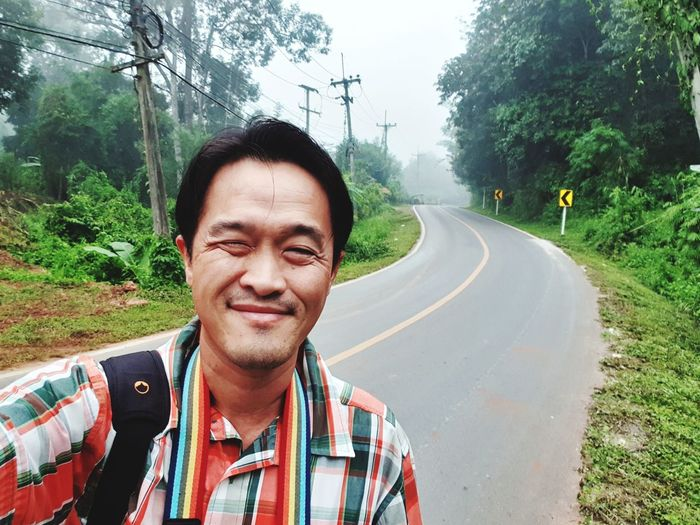 travel in chiang mai Thailand Tree Smiling Portrait Happiness Road Men Cheerful Human Face Rural Scene Empty Road Double Yellow Line Road Marking Country Road Bicycle Lane Yellow Line Dividing Line Growing Mountain Road The Way Forward Countryside Single Lane Road