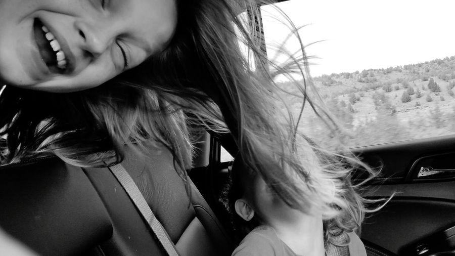 Playful siblings in car