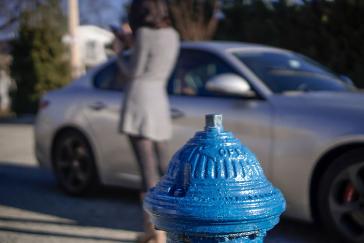 Blur Focus On Foreground NYC New York Water Hydrant Hydrant Street Road Girl One Young Woman Only Dress Day Sunny Blue Car Land Vehicle Close-up Parking Vehicle Stationary