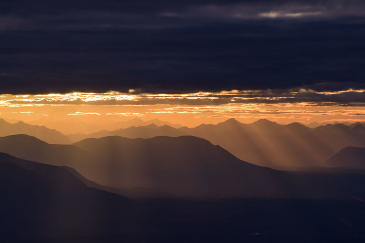Scenic view of mountains against sky during sunset