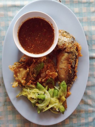 High Angle View Of Fried Fish In Plate On Table