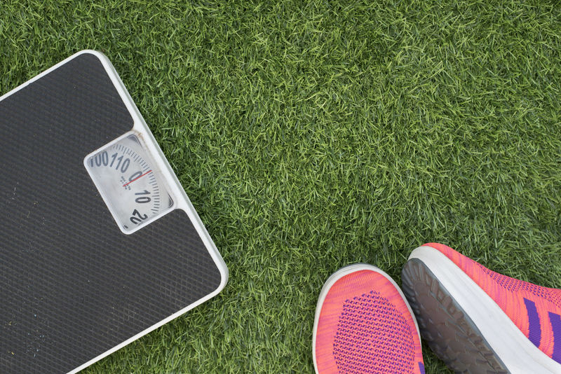 photo of a weighing scale and a sport shoe on green grass( lose weight concept ) Grass Green Weighing Scale Close-up Conceptual Conceptual Photography  Directly Above Fat Fitness Flat Lay Healthy Lifestyle High Angle View Lawn Lose Weight No People Numbers Outdoors Shoes Sports
