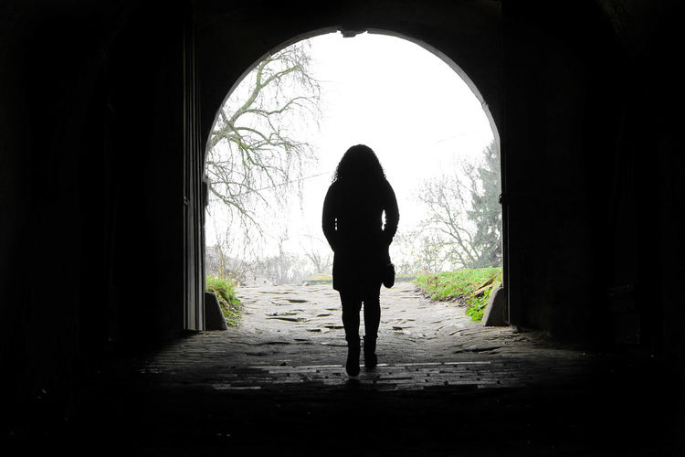 Silhouette Of Person In Tunnel