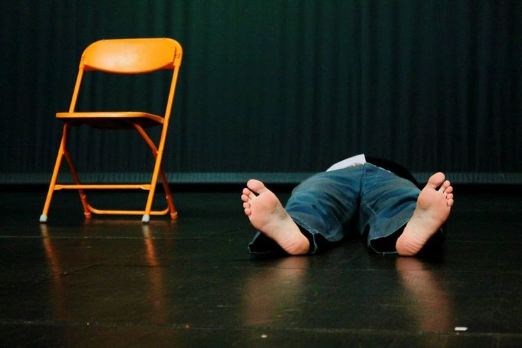 Man lying on chair