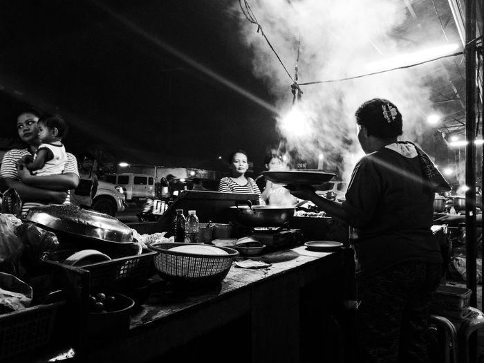 People at restaurant market at night