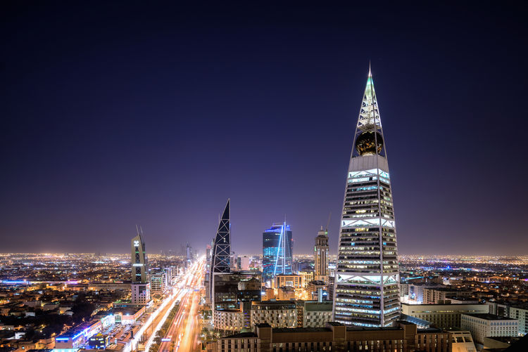 Faisaliah Tower With Cityscape Against Sky At Night