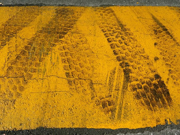 Colors And Patterns Tire Tracks Yellow Textured  Vibrant Color Lines Forensics City Life Urban Security Convergent Bump