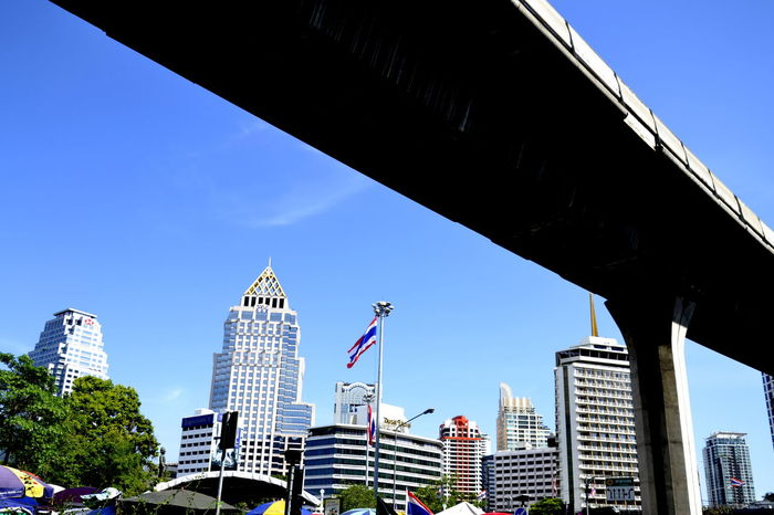 Architecture ASIA Bangkok Thailand. Blue Bridge - Man Made Structure Building Exterior Built Structure City Cityscape Day Growth Low Angle View Modern No People Office Park Outdoors Sky Skyscraper Skytrain Skytrain Bridge Skytrain BTS Skytrainbangkok Thailand Travel Destinations Tree