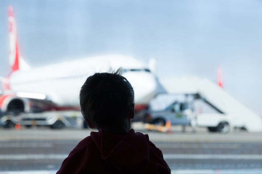 Airplane Airplanes Airport Arrival Arriving Boy Boys Childhood Curious Departing Flight Glass Kids Planes Portrait Real People Terminal Transport Travel Visitor