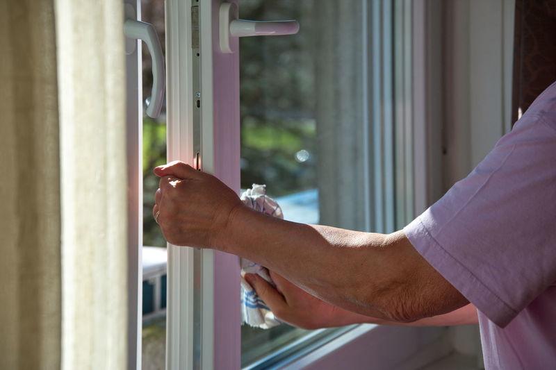 Close-up of man holding window