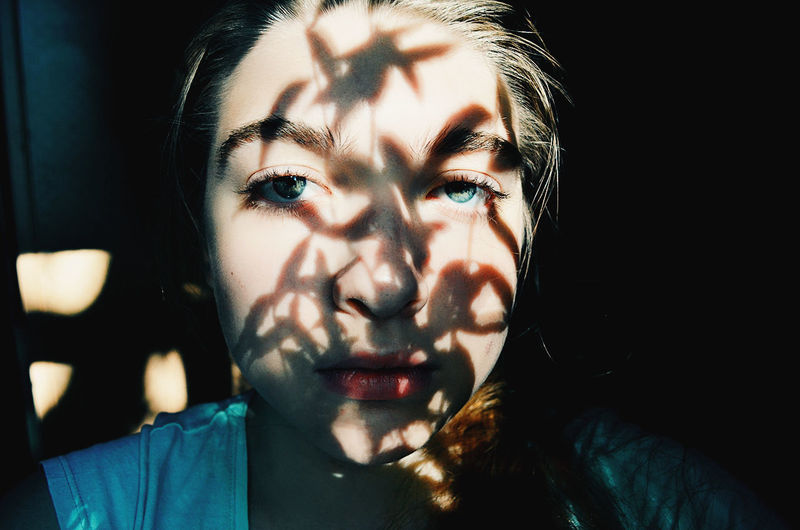 Portrait Human Face One Person Adults Only Adult Headshot Human Body Part Close-up Shadow People Only Women One Woman Only Young Adult Indoors  Human Eye Black Background One Young Woman Only Day