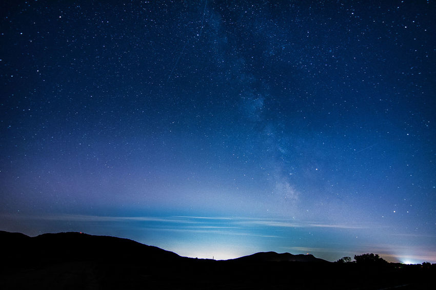 Astronomy Beauty In Nature Blue Galaxy Landscape Light Pollution Milky Way Mountain Nature Night No People Outdoors Scenics Silhouette Sky Space Star - Space Star Field Starry Tranquil Scene Tranquility