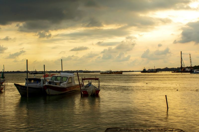 The yellowish time. Malaysia Harbor Sunset_collection Klang Portklang Backgrounds Sunset #sun #clouds #skylovers #sky #nature #beautifulinnature #naturalbeauty #photography #landscape Water Nautical Vessel Sea Sunset Beach Oil Pump Sailing Ship Sky Horizon Over Water Landscape Fishing Boat