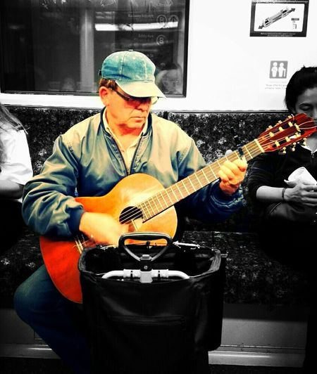 Guitarist on the train taken by FeBird on the way home Mobilephotography