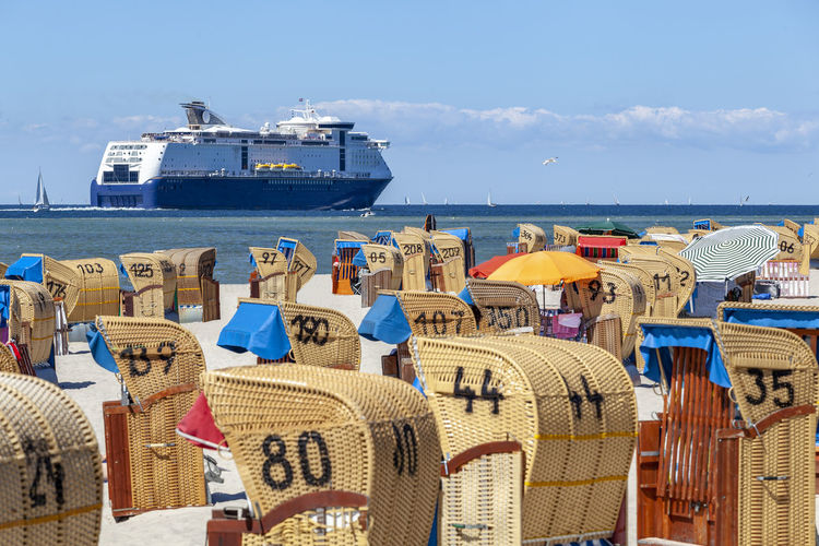 Ferry passing the beach of Laboe, Germany Architecture Chair Cloud - Sky Cruise Ship Day Holiday Hooded Beach Chair Horizon Over Water Mode Of Transportation Nature Nautical Vessel No People Outdoors Passenger Craft Sailboat Sea Ship Sky Transportation Travel Trip Vacations Water