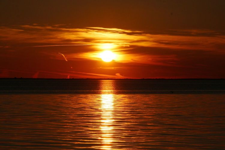 Sunset Sun Nature Water Sea Orange Color Sky Scenics Tranquility Reflection No People Tranquil Scene Shiny Beauty In Nature Finding New Frontiers