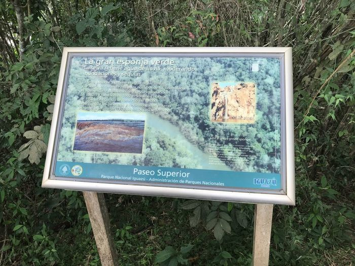 High angle view of information sign on field