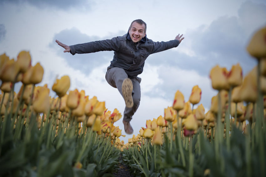 Arms Outstretched Beauty In Nature Day Flower Happiness Low Angle View Nature One Person Outdoors People Plant Real People Sky Tulip Tulips Young Adult The Portraitist - 2017 EyeEm Awards