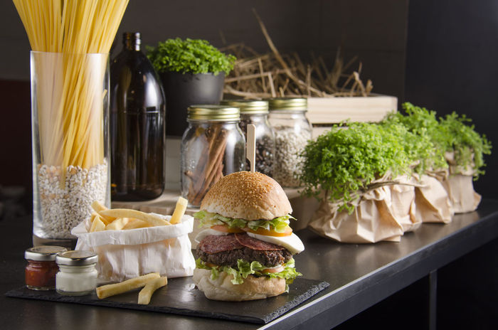 Beef burger and french fried in restaurant. Green Bottle Bun Burger Close-up Day Food Food And Drink French Fries Fried Potatoes Hamburger Indoors  No People Nutrition Ready-to-eat Unhealthy Eating Vegetable