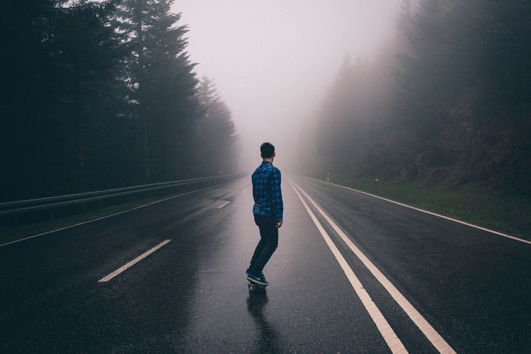 Driving down the road. Black Forest Casual Clothing Country Road Day Diminishing Perspective EyeEm Best Shots Fog Landscape Leisure Activity Lifestyles Motion Nature Outdoors Road Road Marking Sky The Way Forward Transportation Vanishing Point VSCO