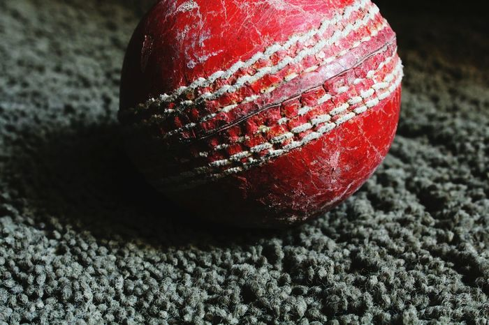 CricketWorldCup Sport Equipment Sports Greencolor Redcolor  Sports Photography Red Cricket Ball