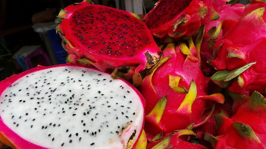 Bright Colors Colorful Dragonfruit Food Fresh Fresh Produce Fruit Market Produce Seeds Spotted In Thailand Thai Food Thailand Unusual What Is It? What Is That? Cut Fruit Whole Fruit Exotic Exotic Fruit White Fruit Deep Color Showcase April