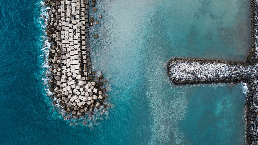 Aerial view of groyne in sea