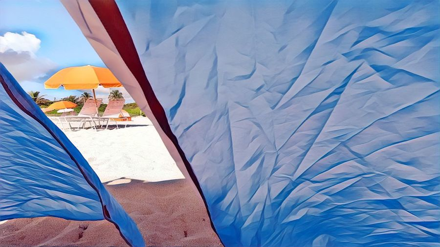 High angle view of tent on beach against sky