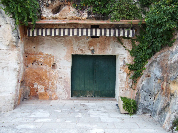 beach hut carved into a cliff face in ciutadella menorca Architecture Entrance Built Structure Door Building Building Exterior No People Wall Day Window House Outdoors Abandoned Old Plant Wall - Building Feature Doorway Nature City Brick Hut Cliff Cave Shack