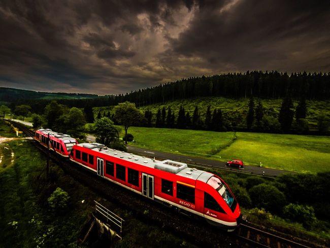 The Illusionist - 2014 EyeEm Awards Regional Train Clouds Red