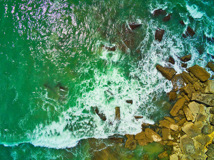 Rocks and Water view from Above Water Sea Nature No People Day Motion Rock Close-up Beauty In Nature Outdoors Solid Wave High Angle View Beach Turquoise Colored Breaking Green Color Power In Nature Rock - Object Aquatic Sport View From Above Drone  Drone Photography 24 Mp Parrot Anafi Looking Down From Above Looking Down