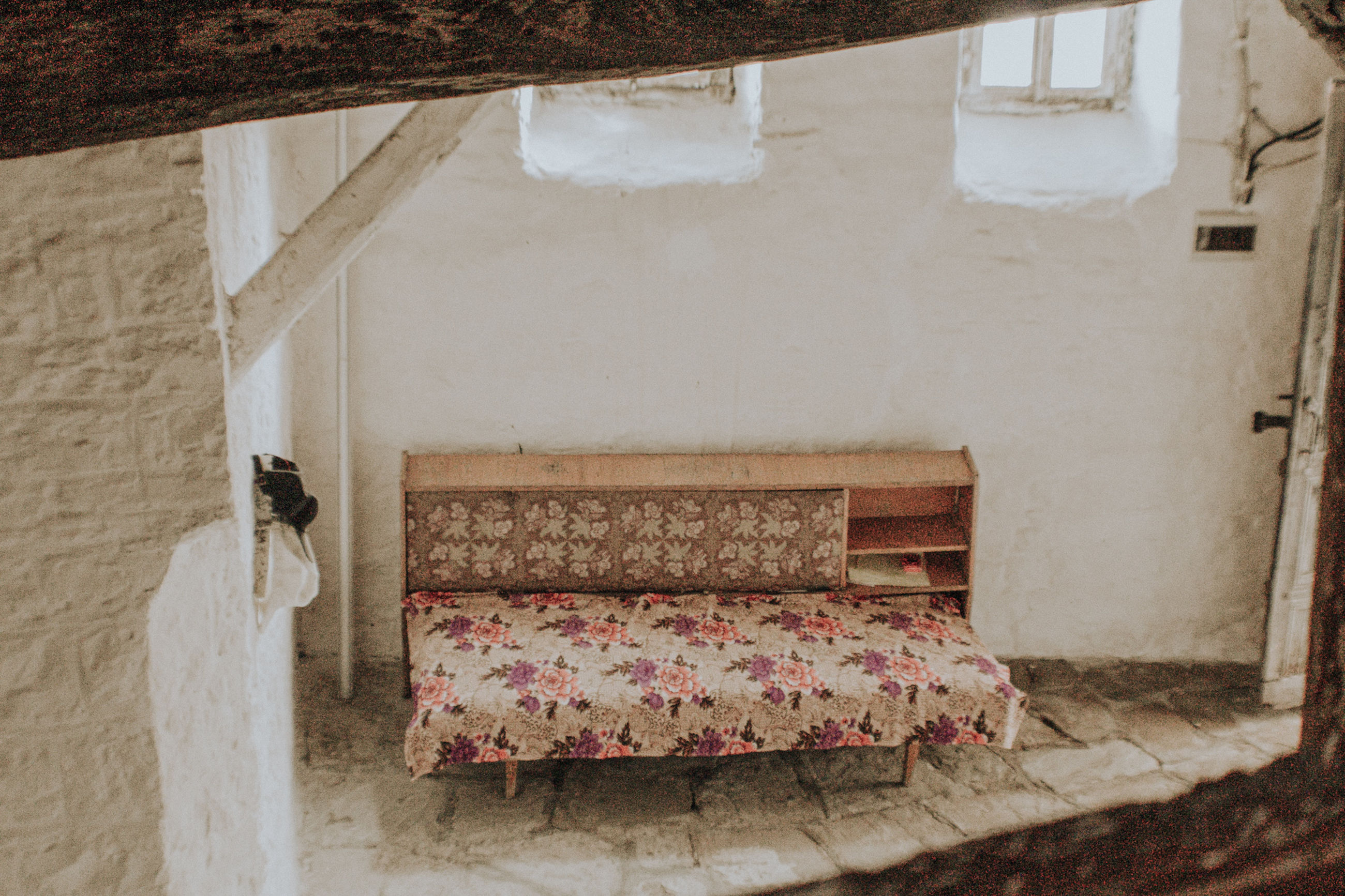 built structure, architecture, indoors, no people, wall - building feature, absence, furniture, bed, old, domestic room, empty, relaxation, wall, building, bedroom, pillow, day, window, abandoned