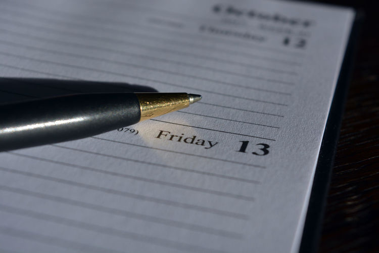 Diary date, Friday 13th Agenda Apprehension Business Business Finance And Industry Close-up Day Diary Finance Folklore Friday Friday 13th Nib No People Page Paper Paraskevidekatriaphobia Pen Superstitions Text Unlucky Date Unlucky Day