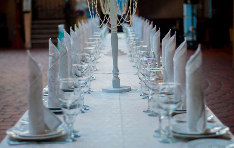 Close-up of glasses on table in restaurant