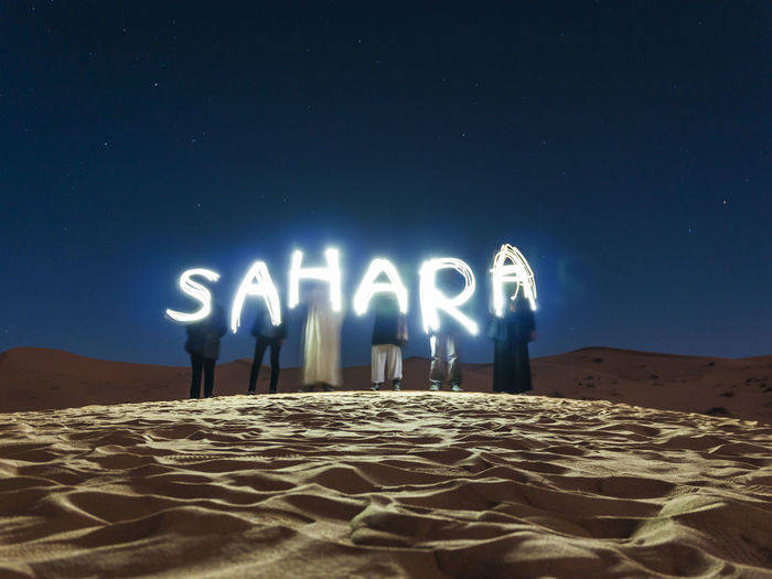 Sahara light painting at Sahara Desert, on a freezing night. Desert Life Light Painting Morocco Travel Africa Arid Climate Astronomy Beauty In Nature Desert Human Representation Illuminated Light Painting Photography Men Nature Night One Person Outdoors People Real People Sahara Sand Sand Dune Sky Star - Space Connected By Travel Perspectives On Nature The Troublemakers The Great Outdoors - 2018 EyeEm Awards Capture Tomorrow