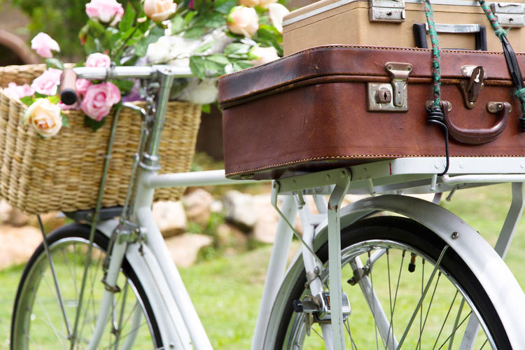 Vintage bicycle on the field with a basket of flowers and bag Old Fashioned Vintage Style Vintage Bicycle Basket Bicycle Bicycle Basket Bicycle Rack Bike Close-up Day Flower Focus On Foreground Land Vehicle Mode Of Transport Nature No People Outdoors Stationary Transportation Vintage Wheel