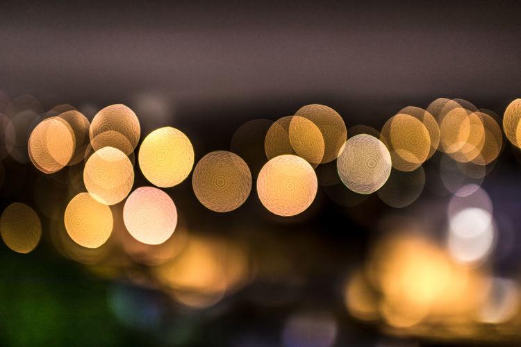 Defocused image of illuminated lights at night