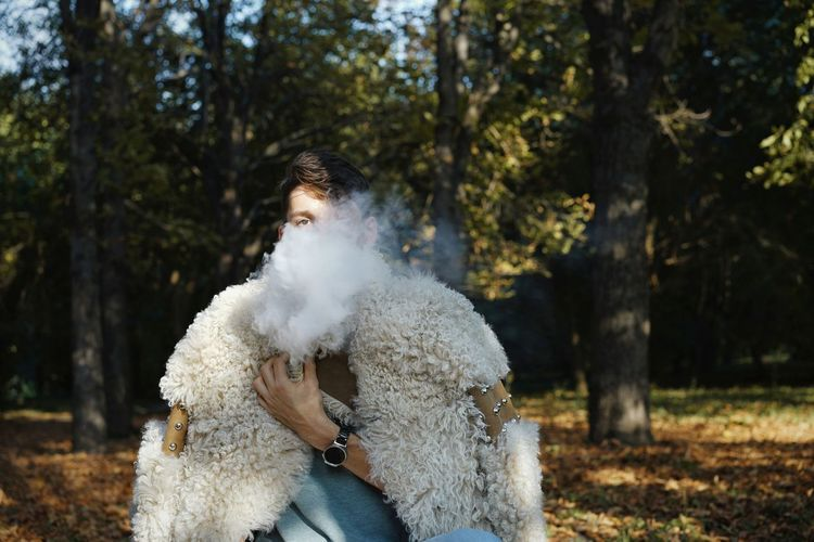 -with @matthias4 Smoke Smoke - Physical Structure Vape Vaping Men Tree Forest Portrait Autumn Close-up Smoking Warm Clothing Bad Habit Fur Coat Wearing Friend Winter Coat Addiction Tobacco Product Smoking Issues Be Brave