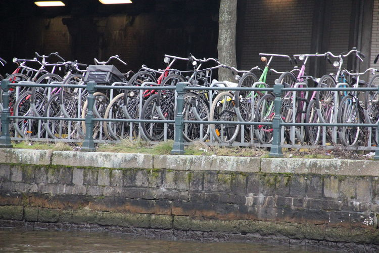 bicycle parking, row of bikes parked. Amsterdam / Netherlands. Fahrrad Fahrradständer Fiets Fietsenstalling Bicycle Rack Bikes Bikesaroundtheworld Day Fietsen No People Outdoors Railing Street Street Photography Streetphotography Urban Urbanphotography Water EyeEmNewHere