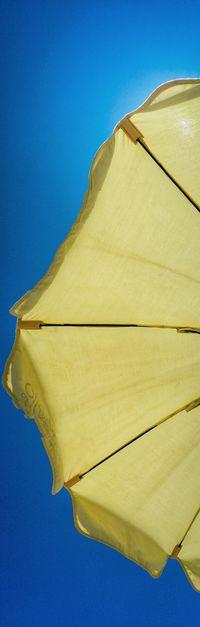 Partial view of a yellow beach umbrella