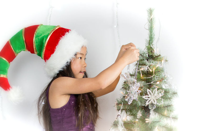 Christmas decorating Chinese Girl Christmas Cute Cute Christmas Day Festive Festive Fun Girl Happy Long Black Hair One Person People Portrait Of Girl At Xmas Portraits Pretty Girl Smile Streamzoofamily Winter Winter Wonderland Xmas