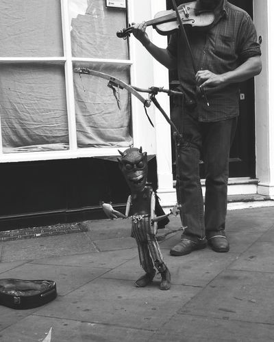 Street Photography One Man Only One Person Standing Outdoors Streetart Musician Puppet Play Devil Dancing York