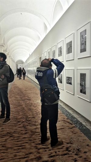 Snap A Stranger Men Photo Expo Real People Perspective Photo Exhibition Ai Wei Wei Architecture Built Structure Arched Ceilings Photograph People Watching People And Art People Visitors In My City