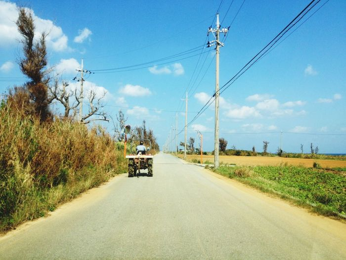 Man Driving Tractor On Country Road
