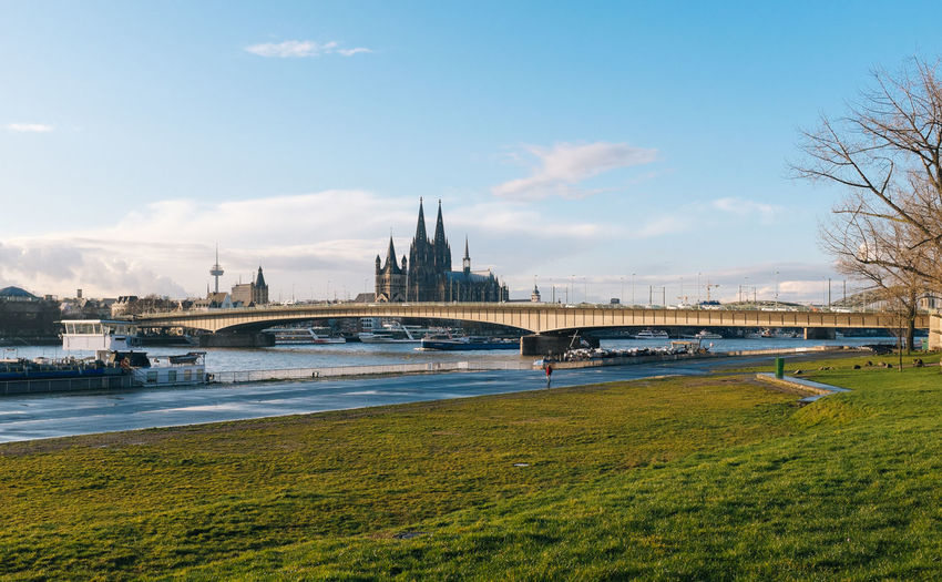 Deutz suspension bridge over rhine river with cologne cathedral against sky