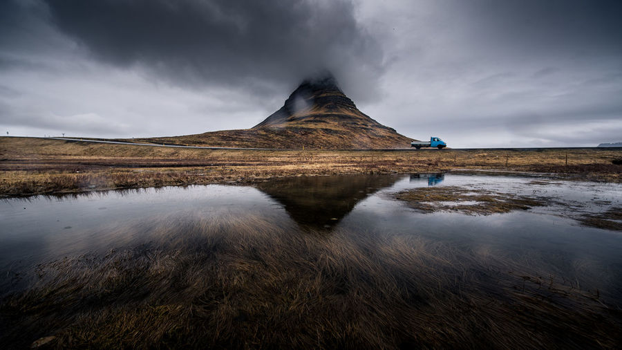 kirkjufell at water reflection of kirkjufell with really smooth water picturesque iceland nature Iceland Kirkjufell Reflection Travel Beauty In Nature Cloud - Sky Day Environment Idyllic Lake Land Landscape Landscape_photography Landscapes Mountain Nature No People Non-urban Scene Outdoors Reflection Scenics - Nature Sky Tranquil Scene Tranquility Water